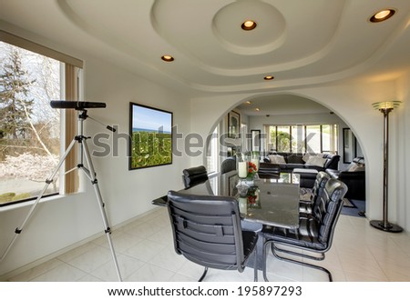 Elegant dining room with archway and modern dining table set.