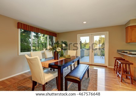 Elegant dining room with fresh flowers on the table. Glass doors lead to the back deck. Northwest, USA