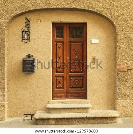 elegant doorway to the tuscan house with many vintage elements, Italy, Europe - stock photo