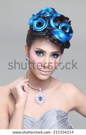 elegant fashion brunette Thai woman posing with creative chignon hair-style  - stock photo