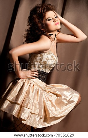 elegant fashionable woman in beautiful dress