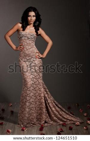elegant fashionable woman in beige dress - stock photo