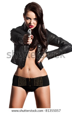 elegant fashionable woman with a pistol in hands - stock photo