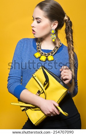 Elegant fashionable woman with bag - stock photo