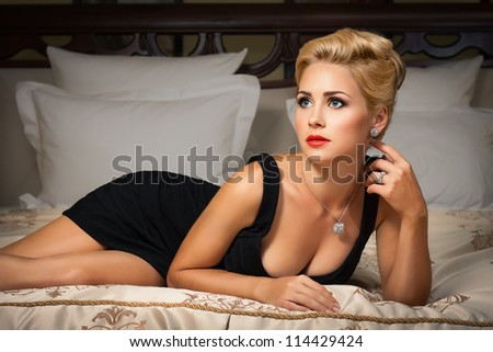 Elegant fashionable woman with diamond jewelry. Fashion shoot. - stock photo