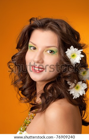 elegant fashionable woman with flowers  on yellow background