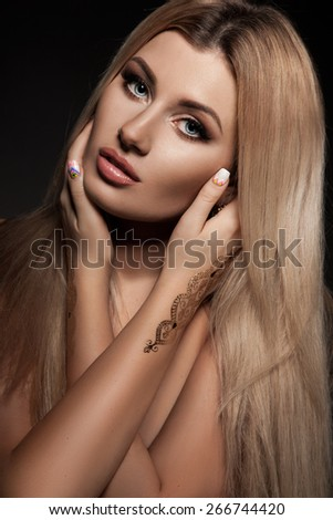 elegant fashionable woman with golden paints - stock photo