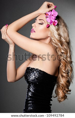 elegant fashionable woman with orchid