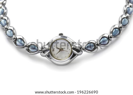 Elegant female silver wristwatch on white background - stock photo