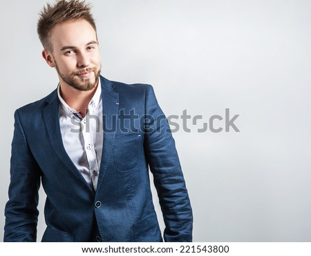 Elegant & friendly young handsome man in costume. Studio fashion portrait.