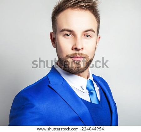 Elegant & friendly young handsome man in fashionable costume. Studio man portrait.  - stock photo