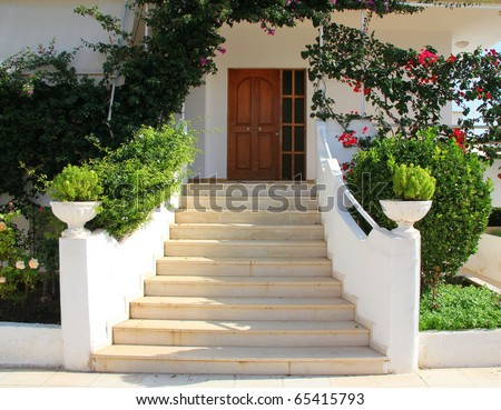 Elegant Front Door of Home. Greece - stock photo