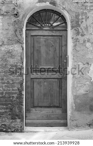elegant front door to the Tuscan house, Italy (black and white) - stock photo