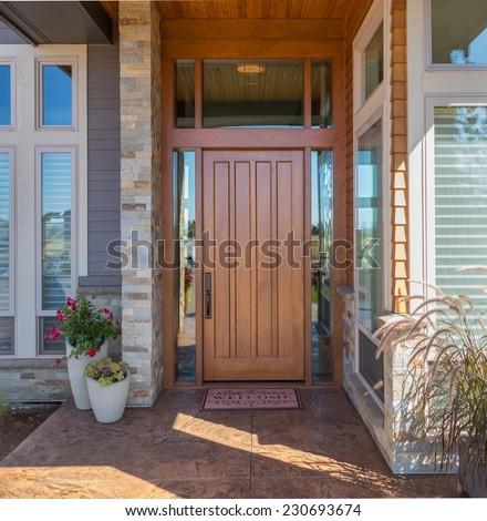Elegant front door with welcome mat - stock photo