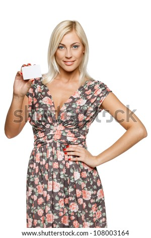 Elegant girl showing an empty credit card, over white background