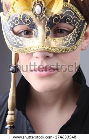 Elegant girl with a wonderful mask studio shot - stock photo