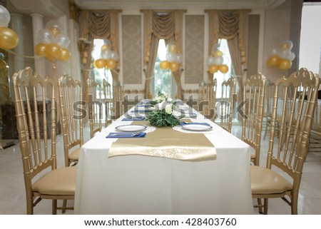 elegant gold theme dining table - stock photo