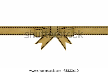 Elegant gold yellow ribbon gift bow with brown stitching on white background - stock photo