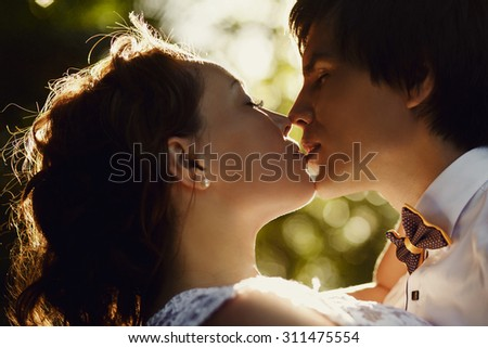 elegant gorgeous bride and groom kissing in tropical forest , wedding ceremony in Seychelles