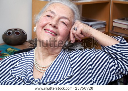 Elegant grandmother portrait with pearls - stock photo
