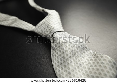 Elegant gray tie on a black background in the style fifty shades of gray - SOFT FOCUS - stock photo