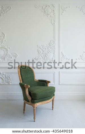 elegant green armchair in luxury clean bright white interior - stock photo