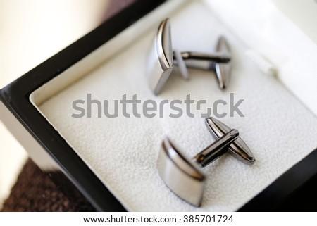 Elegant groom's cufflinks - stock photo