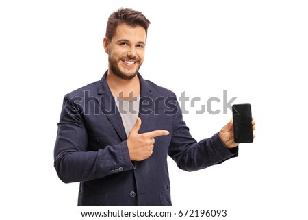 Elegant guy holding a phone and pointing isolated on white background
