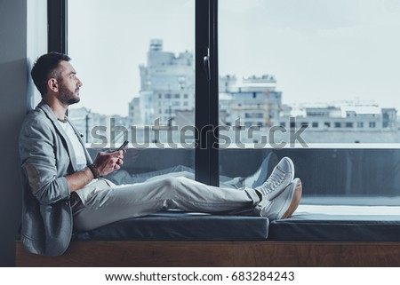 Elegant guy is enjoying urban landscape