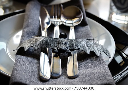 Elegant Halloween Table Settings In Black White Colors, Silver Cutlery And  Napkin Ring With Bat