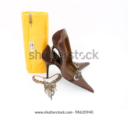 Elegant handbag ,shiny jewelry and shoes for women - stock photo