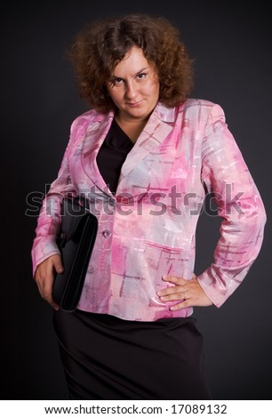 elegant heavy businesswoman over dark background