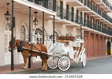 Elegant horse-drawn carriage in French Quarter, New Orleans - stock photo