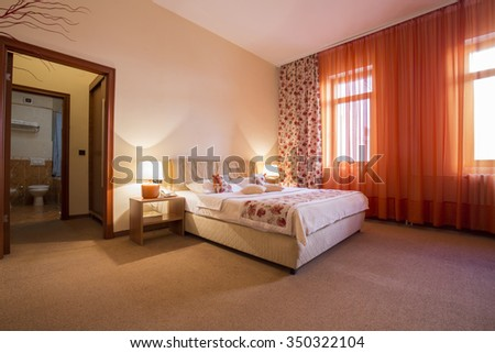 Elegant hotel bedroom interior - stock photo