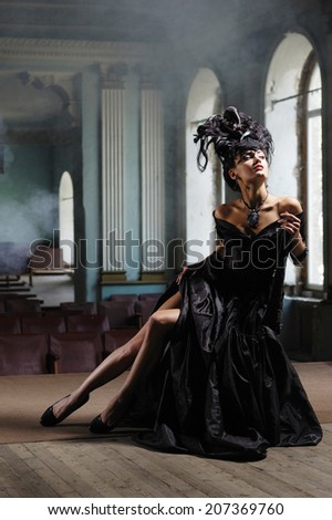 elegant lady in black dress with luxurious hairstyle