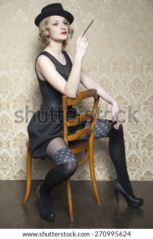 elegant lady with a cigarette - stock photo