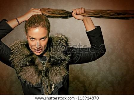 elegant lady with fur of fox - stock photo