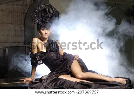 elegant lady with luxurious hairstyle on smoke background