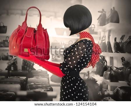 Elegant lady with stylish short hairstyle holding a bag - stock photo