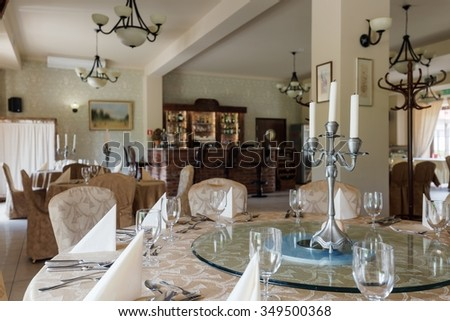 Elegant laid tables in luxury banquet room - stock photo