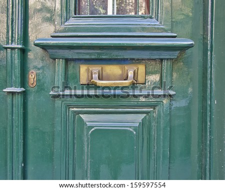 elegant light green door close-up - stock photo