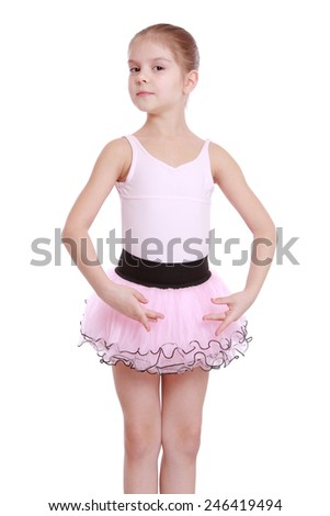 elegant little ballerina in a pink tutu dancing classic ballet  - stock photo