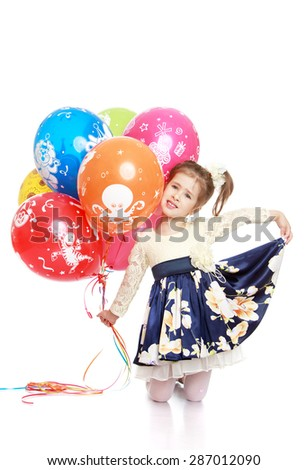 Elegant little girl in a beautiful long dress holding a bunch of balloons-Isolated on white background - stock photo
