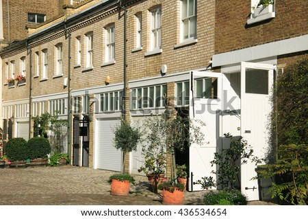Elegant London terraced mews houses in Kensington and Chelsea, London, England, UK  converted from old horse stables - stock photo