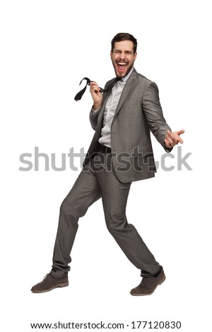 elegant man in grey suit dancing on white background - stock photo