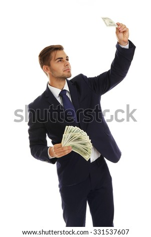 Elegant man in suit holding money isolated on white