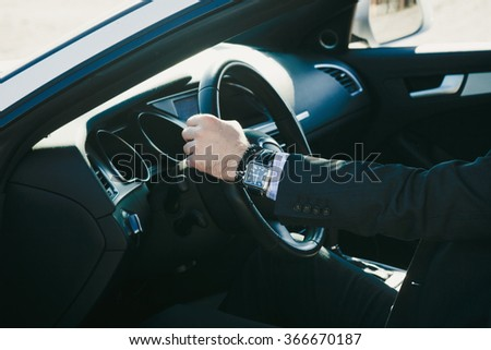 elegant man in suit sit in his car, closeup, natural light, shallow depth of field