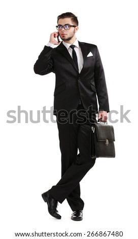 Elegant man in suit with mobile phone and briefcase isolated on white - stock photo