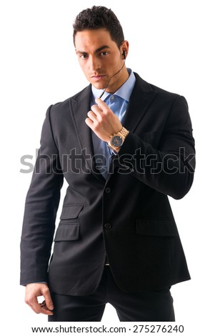 Elegant man ressed as bodyguard or security agent, with earphones, isolated on white - stock photo