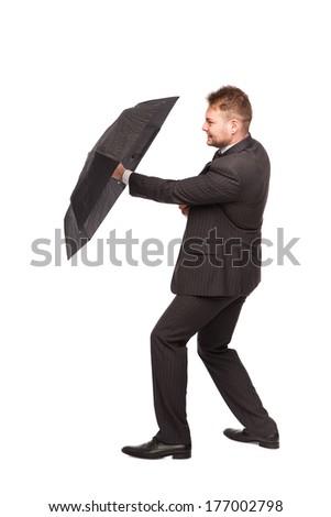 elegant man using umbrella to defend himself isolated - stock photo